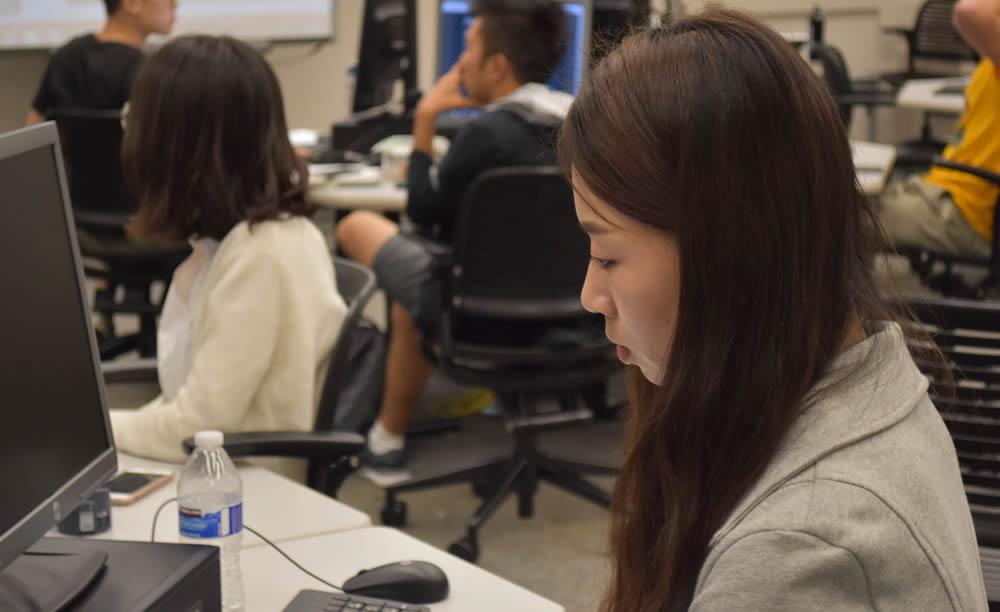 Photo of UW Biostatistics student at computer