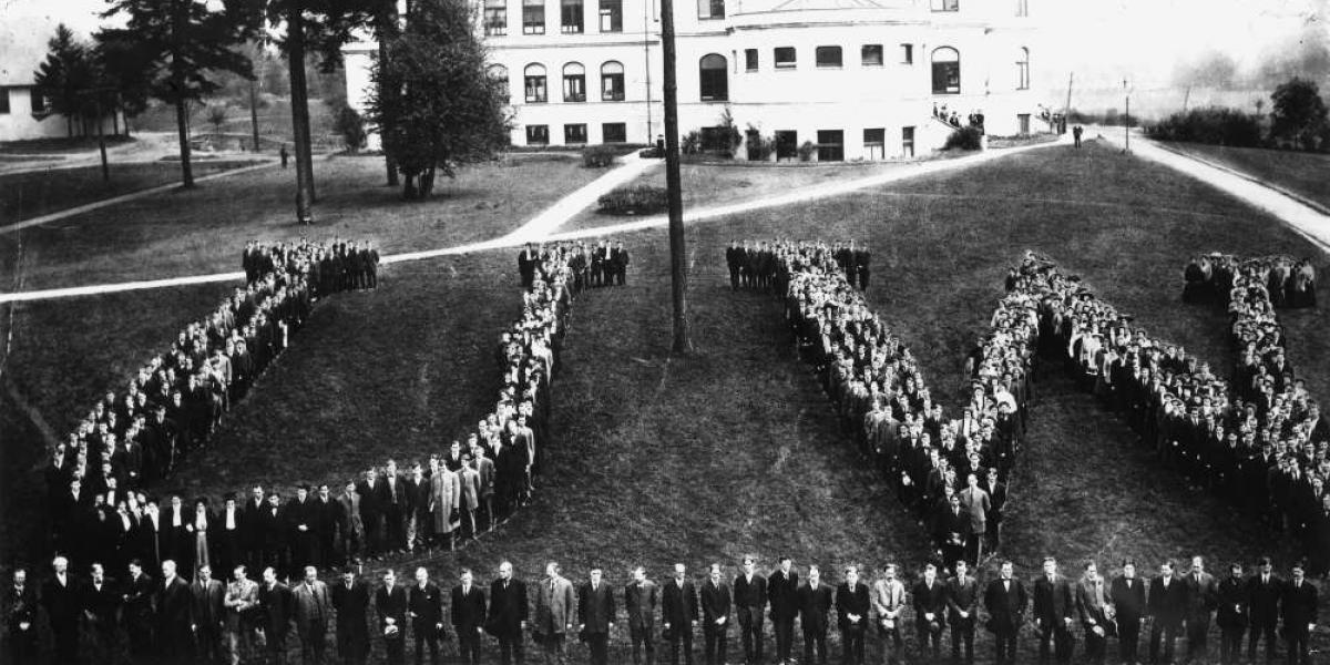 Graduates forming shape of UW, University of Washington, 1909.